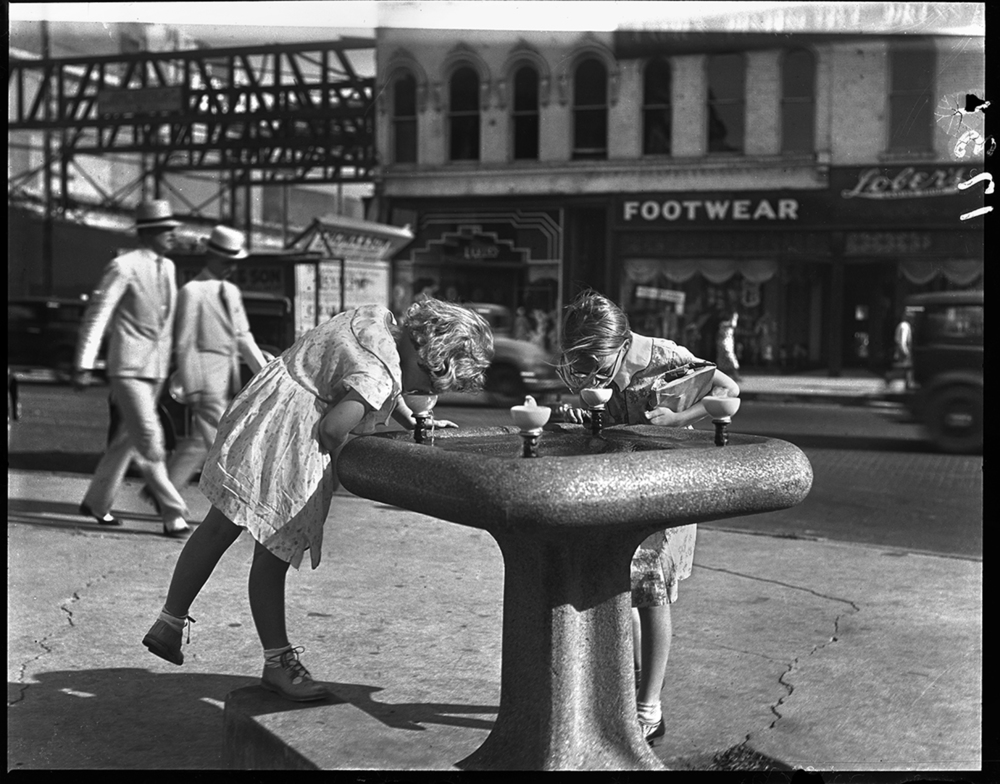 Drinking fountain at SE corner of courthouse square, Fifth and Adams streets, Montgomery Ward store at 506-510 E. Adams under construction in back at left., circa 1930. File/The State Journal-Register