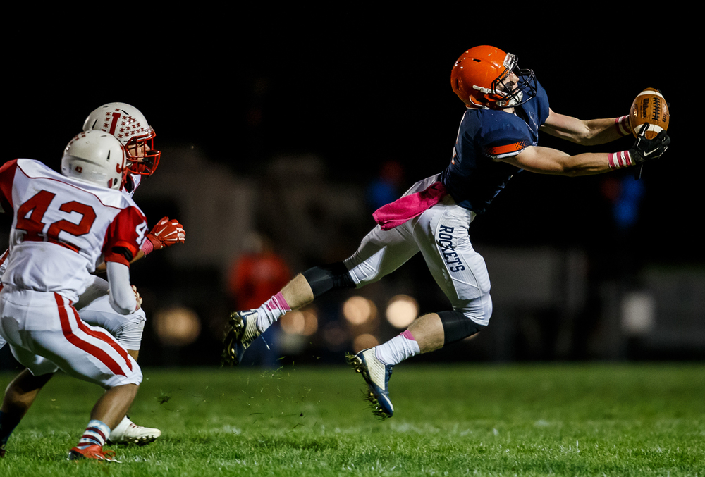 Rochester's Eric Yakle (2) makes a leaping catch for a first down against Jacksonville during the first half at Rocket Booster Field, Friday, Oct. 10, 2014, in Rochester, Ill. Justin L. Fowler/The State Journal-Register
