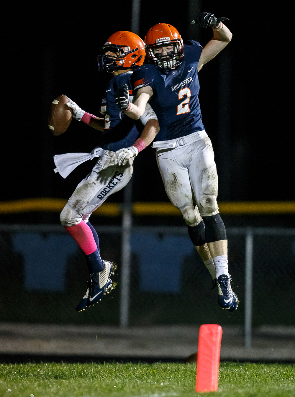 Rochester's Jeremy Bivens (15) celebrates his 73-yard touchdown catch with Rochester's Eric Yakle (2) against Jacksonville during the second half at Rocket Booster Field, Friday, Oct. 10, 2014, in Rochester, Ill. Justin L. Fowler/The State Journal-Register