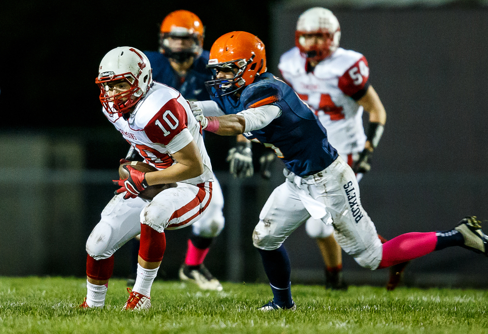Jacksonville's Noah Pickens (10) pulls in a pass against Rochester's Jeremy Bivens (15) during the first half at Rocket Booster Field, Friday, Oct. 10, 2014, in Rochester, Ill. Justin L. Fowler/The State Journal-Register