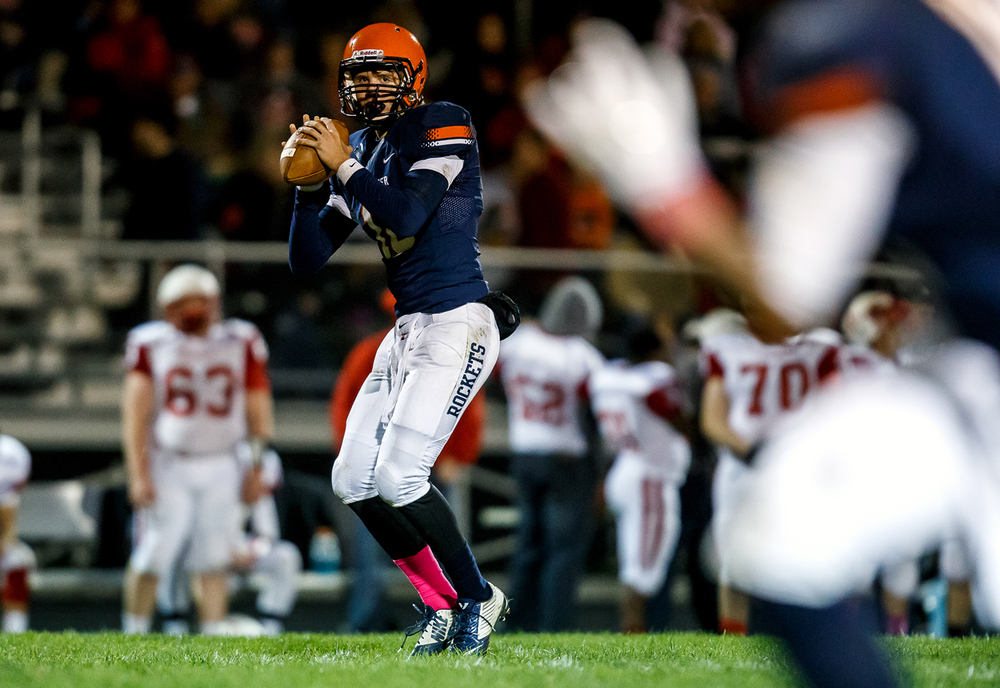 Rochester quarterback Danny Zeigler (10) looks downfield towards an open receiver for a pass against Jacksonville during the first half at Rocket Booster Field, Friday, Oct. 10, 2014, in Rochester, Ill. Justin L. Fowler/The State Journal-Register