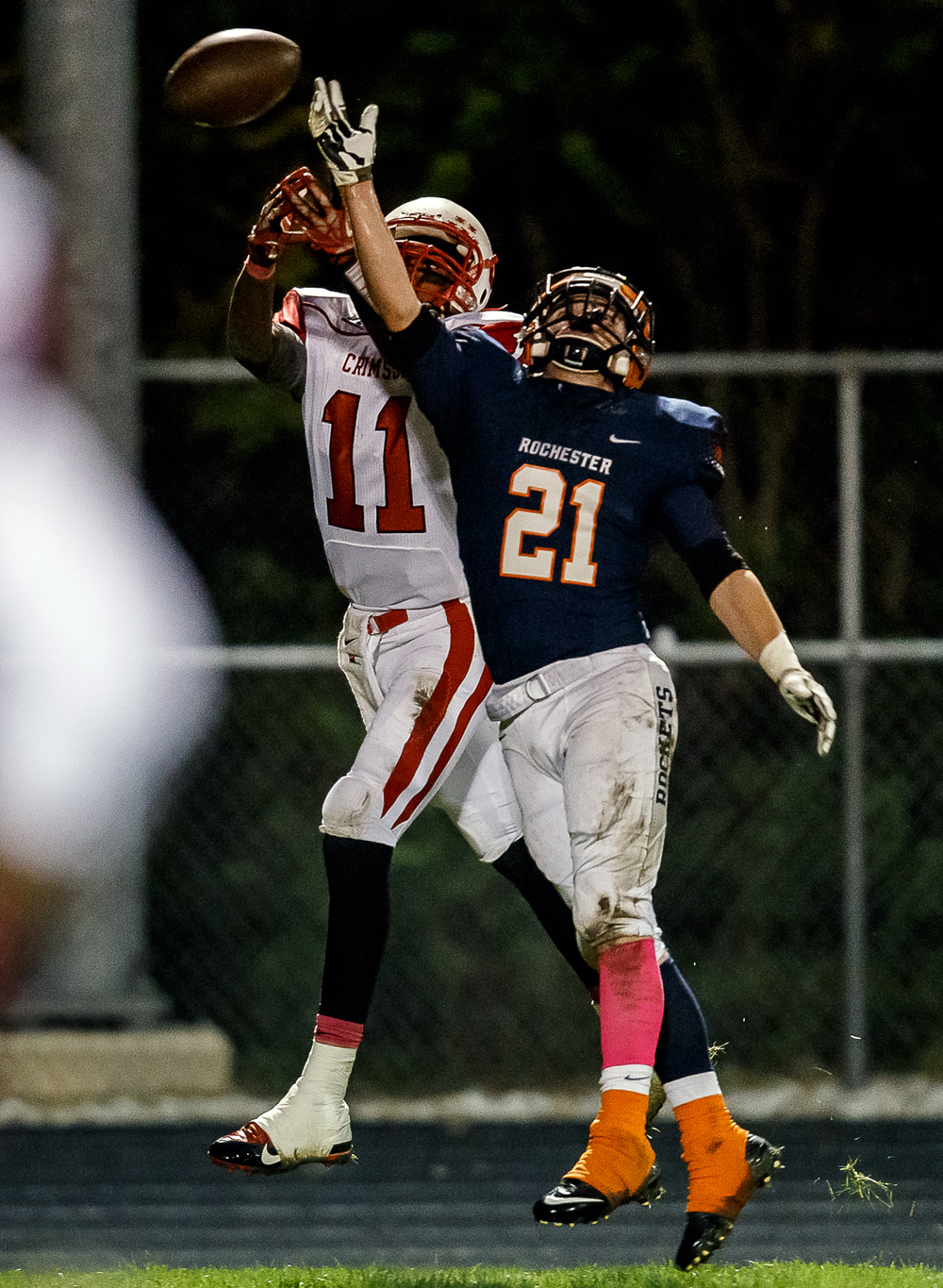 Rochester's Kenny Hedges (21) breaks up a pass intended for Jacksonville's James White (11) during the first half at Rocket Booster Field, Friday, Oct. 10, 2014, in Rochester, Ill. Justin L. Fowler/The State Journal-Register