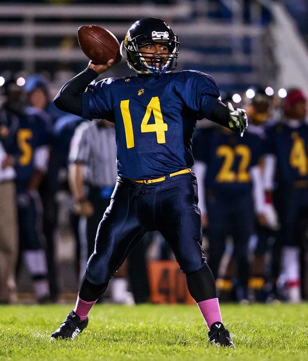 Southeast quarterback Isaiah Timms (14) loads up on a pass against Sacred Heart-Griffin during the first half at Southeast High School, Friday, Oct. 17, 2014, in Springfield, Ill. Justin L. Fowler/The State Journal-Register