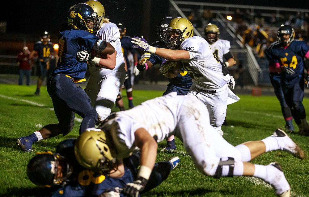 Sacred Heart-Griffin's Sam Sergent (28) follows a block from lineman Quinn Oseland (78) for a touchdown against Southeast during the first half at Southeast High School, Friday, Oct. 17, 2014, in Springfield, Ill. Justin L. Fowler/The State Journal-Register