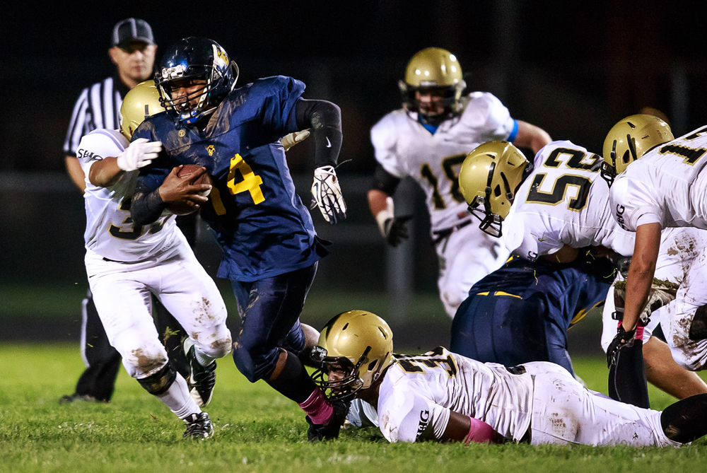 Southeast quarterback Isaiah Timms (14) is brought down by Sacred Heart-Griffin's DJ Mackey (38) on a run during the first half at Southeast High School, Friday, Oct. 17, 2014, in Springfield, Ill. Justin L. Fowler/The State Journal-Register