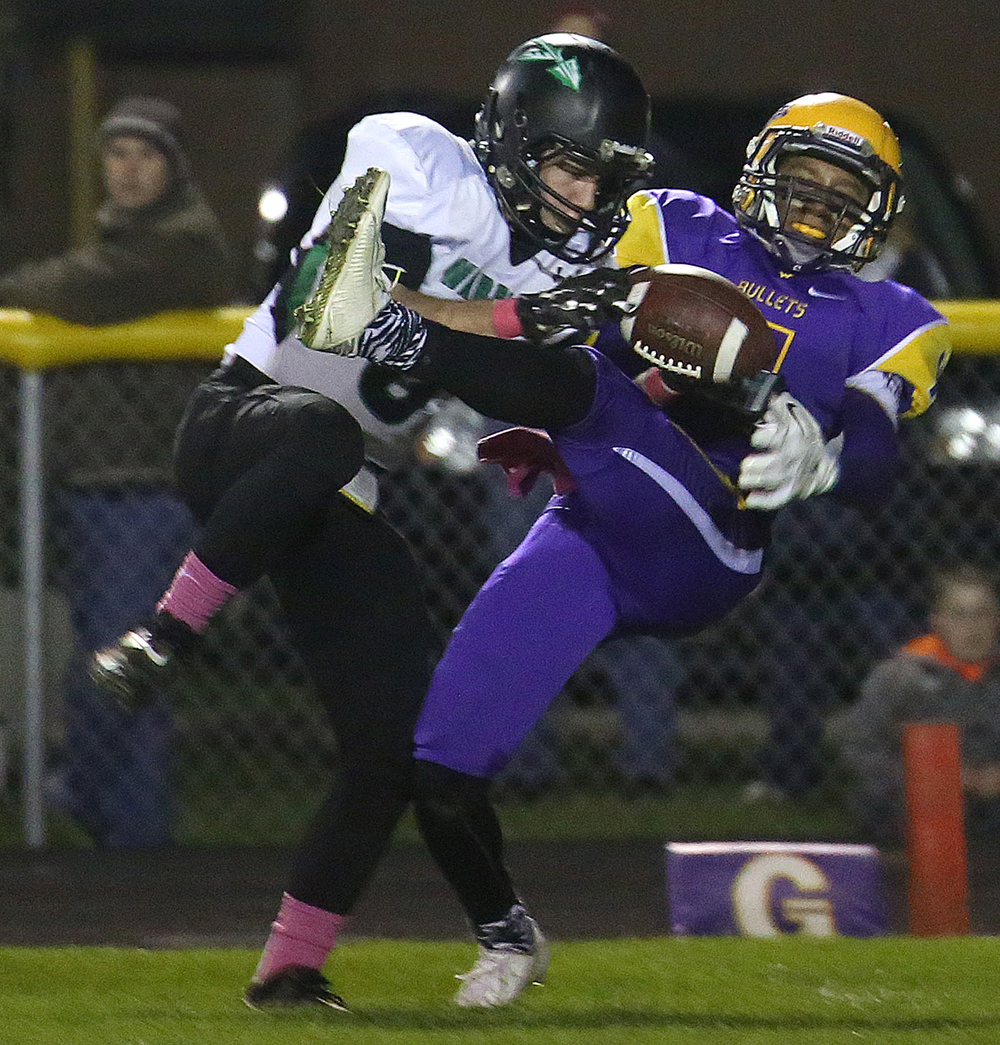 Warriors defender Matthew Selinger intercepts this pass intended for Bullets receiver D'ante Cox late in the first half. The Williamsville Bullets defeated the Athens Warriors 34-13 in high school football action at Paul Jenkins Field in Williamsville on Friday, Oct. 17, 2014. David Spencer/The State Journal-Register