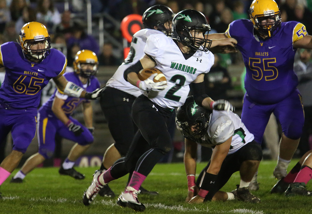 Warriors ballcarrier Scott Grieve runs for first half yardage.The Williamsville Bullets defeated the Athens Warriors 34-13 in high school football action at Paul Jenkins Field in Williamsville on Friday, Oct. 17, 2014. David Spencer/The State Journal-Register