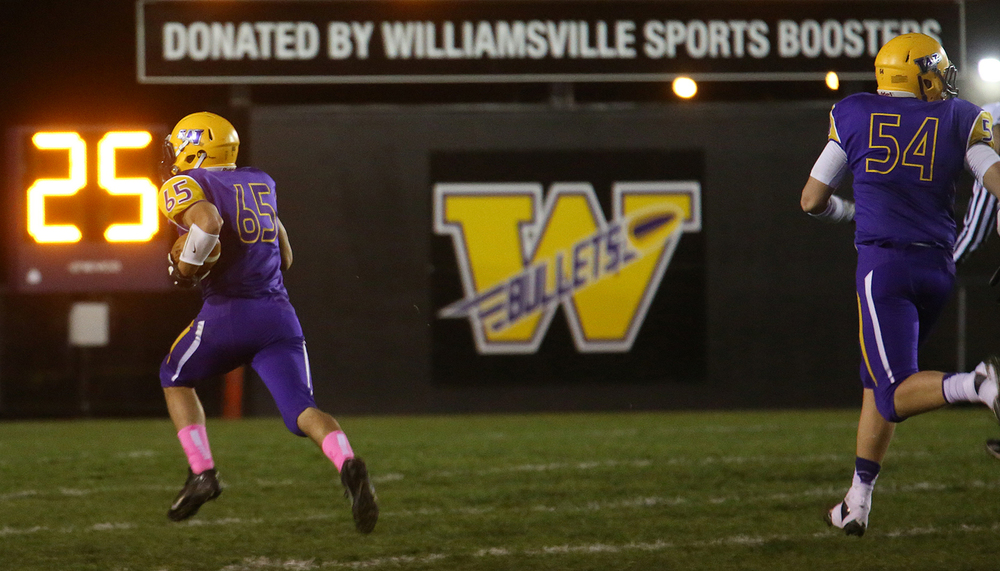 A fumbled ball was run for the Bullets third touchdown by ballcarrier John Karras. The Williamsville Bullets defeated the Athens Warriors 34-13 in high school football action at Paul Jenkins Field in Williamsville on Friday, Oct. 17, 2014. David Spencer/The State Journal-Register
