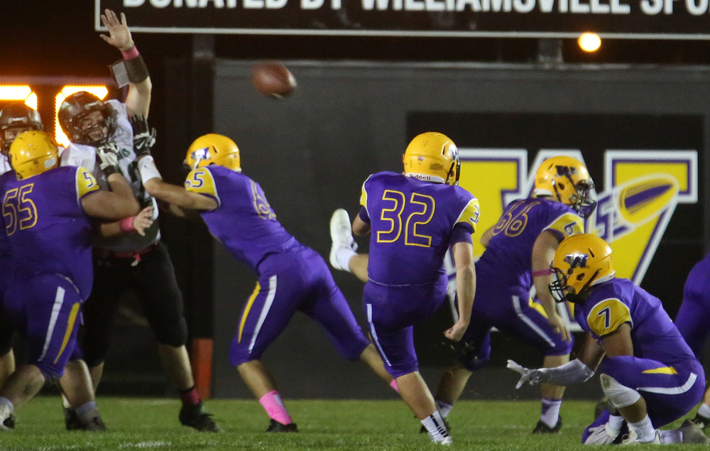 The extra point is kicked successfully by Bullets punter Adam Clark after his team's third touchdown of the night. The Williamsville Bullets defeated the Athens Warriors 34-13 in high school football action at Paul Jenkins Field in Williamsville on Friday, Oct. 17, 2014. David Spencer/The State Journal-Register