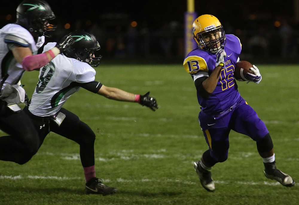 Bullets ballcarrier Jace Franklin runs for yardage. The Williamsville Bullets defeated the Athens Warriors 34-13 in high school football action at Paul Jenkins Field in Williamsville on Friday, Oct. 17, 2014. David Spencer/The State Journal-Register