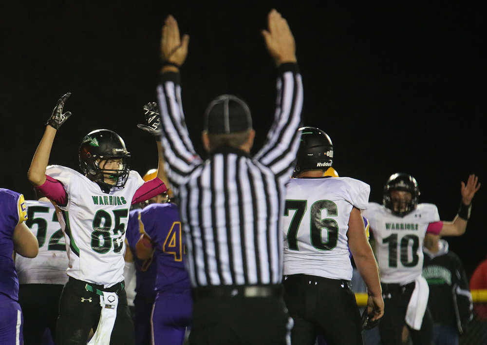 Athens players celebrate their first touchdown of the night made by Chris Basso. The Williamsville Bullets defeated the Athens Warriors 34-13 in high school football action at Paul Jenkins Field in Williamsville on Friday, Oct. 17, 2014. David Spencer/The State Journal-Register
