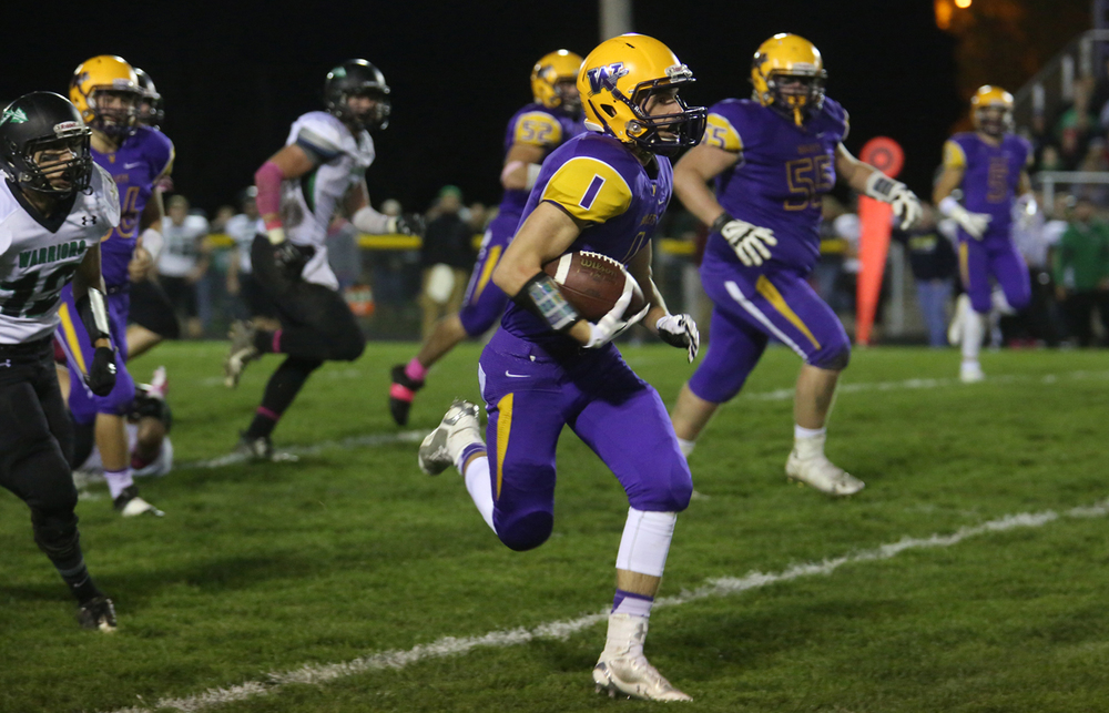 Bullets ballcarrier Daniel Daykin sprints downfield with the ball. The Williamsville Bullets defeated the Athens Warriors 34-13 in high school football action at Paul Jenkins Field in Williamsville on Friday, Oct. 17, 2014. David Spencer/The State Journal-Register