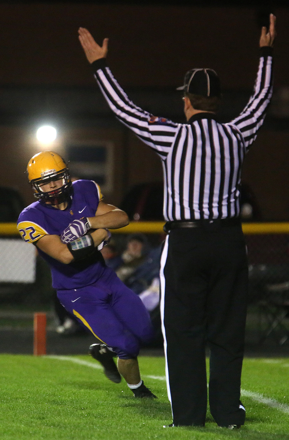 An official signals a touchdown, the fourth by the Bullets, carried by Tate Manka. The Williamsville Bullets defeated the Athens Warriors 34-13 in high school football action at Paul Jenkins Field in Williamsville on Friday, Oct. 17, 2014. David Spencer/The State Journal-Register