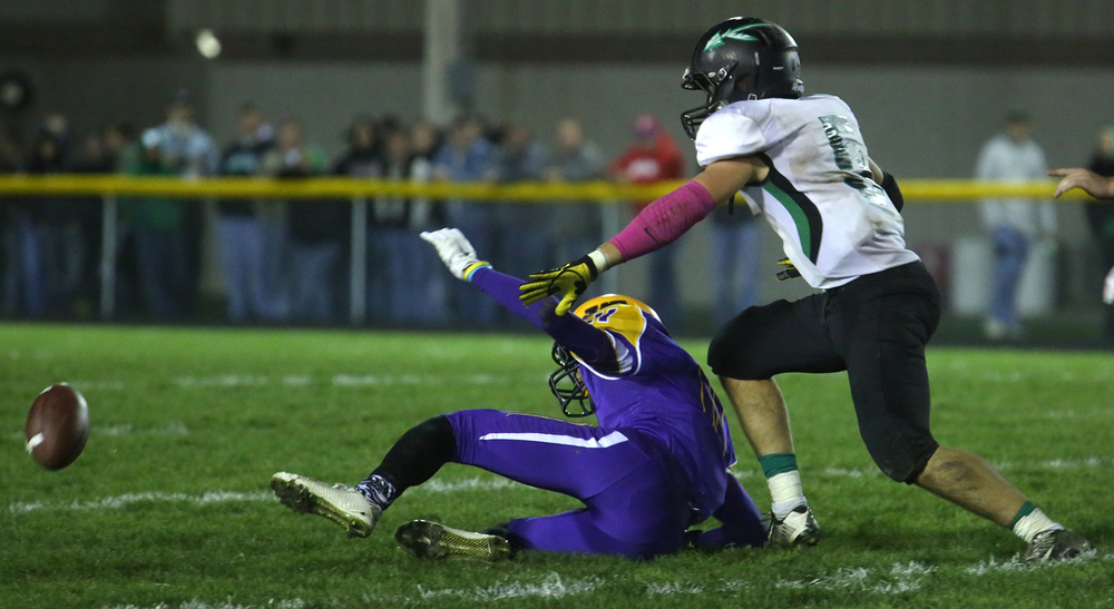 A fumble by Athens lead to this loose ball being recovered by the Bullets. The Williamsville Bullets defeated the Athens Warriors 34-13 in high school football action at Paul Jenkins Field in Williamsville on Friday, Oct. 17, 2014. David Spencer/The State Journal-Register