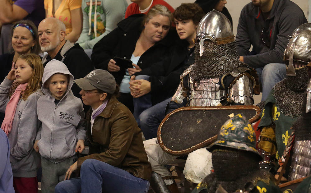 Fighters from the Detroit Fight Club watch a bout while sitting with spectators Saturday. The Medieval battle competition Battle of the Nations International Tournament of Chivalry took place at the Livestock Center on the Illinois State Fairgrounds in Springfield on Saturday, Oct. 18, 2014. Armored sword fighters competed in the full contact sport individually and as teams from around the world for medals.  David Spencer/The State Journal-Register