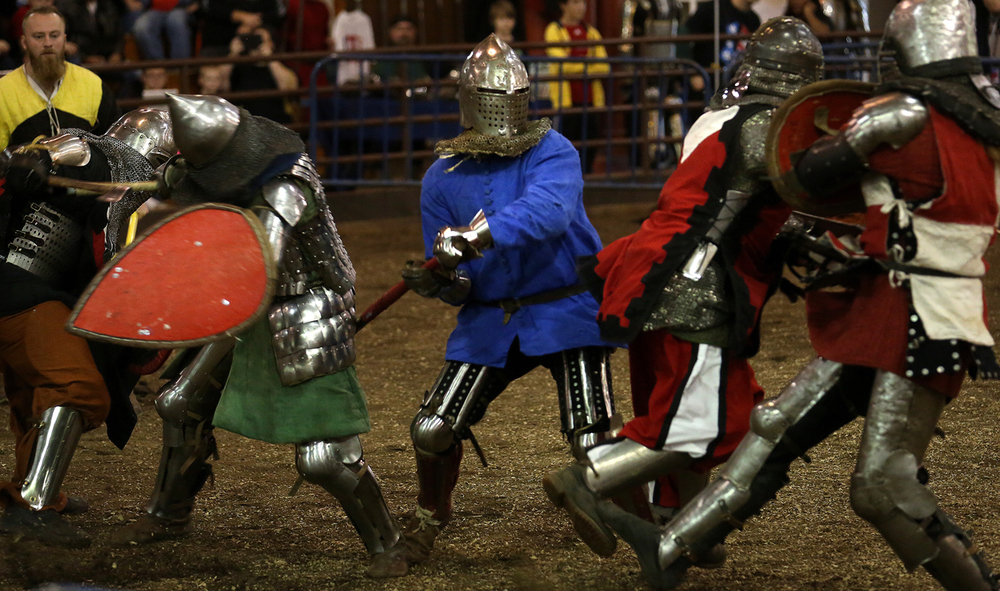 A fighter from Team Syabri Belarus (in blue) at center is surrounded by others including those from the Company of the Iron Phoenix. The Medieval battle competition Battle of the Nations International Tournament of Chivalry took place at the Livestock Center on the Illinois State Fairgrounds in Springfield on Saturday, Oct. 18, 2014. Armored sword fighters competed in the full contact sport individually and as teams from around the world for medals.  David Spencer/The State Journal-Register