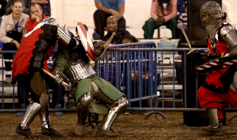 Fighters from Team Syabri Belarus and from the Company of the Iron Phoenix mix it up. The Medieval battle competition Battle of the Nations International Tournament of Chivalry took place at the Livestock Center on the Illinois State Fairgrounds in Springfield on Saturday, Oct. 18, 2014. Armored sword fighters competed in the full contact sport individually and as teams from around the world for medals.  David Spencer/The State Journal-Register