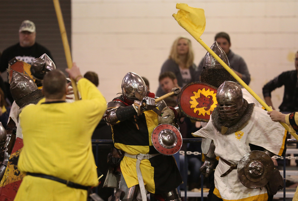 Battle competition on Saturday. Marshals wielding flags made sure rules of engagement were followed properly. The Medieval battle competition Battle of the Nations International Tournament of Chivalry took place at the Livestock Center on the Illinois State Fairgrounds in Springfield on Saturday, Oct. 18, 2014. Armored sword fighters competed in the full contact sport individually and as teams from around the world for medals.  David Spencer/The State Journal-Register