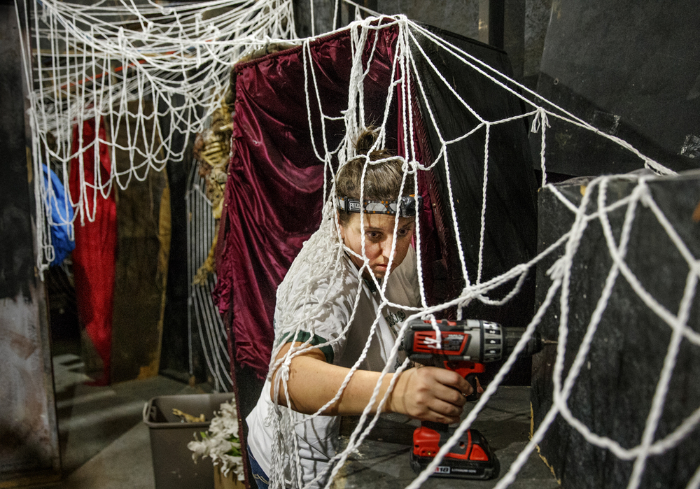 Kate Darneille installs low voltage lighting behind a spider web in the Boo Crew's haunted house Wednesday, Oct. 1, 2014. The Rochester Lions Club's new 7,200 foot permanent facility opens Friday. Ted Schurter/The State Journal-Register