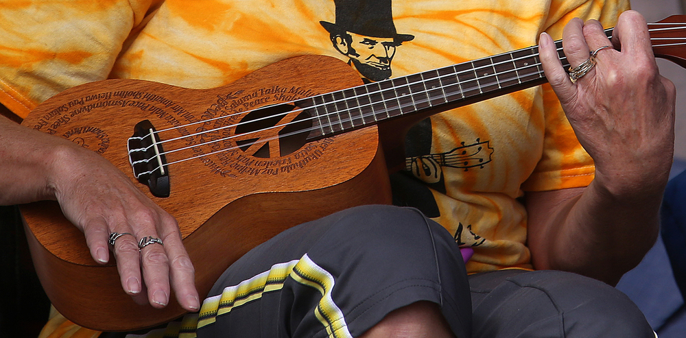 A close-up shows the concert ukulele played by Springfield's Vera Mount, with a carved PEACE sign integrated into the instrument. A performance by the Springfield Ukutopians, a group of area people who play and love the ukulele, took place at the Springfield Art Association as part of their Fine Art fair on Sunday, Sept. 21, 2014. David Spencer/The State Journal-Registe