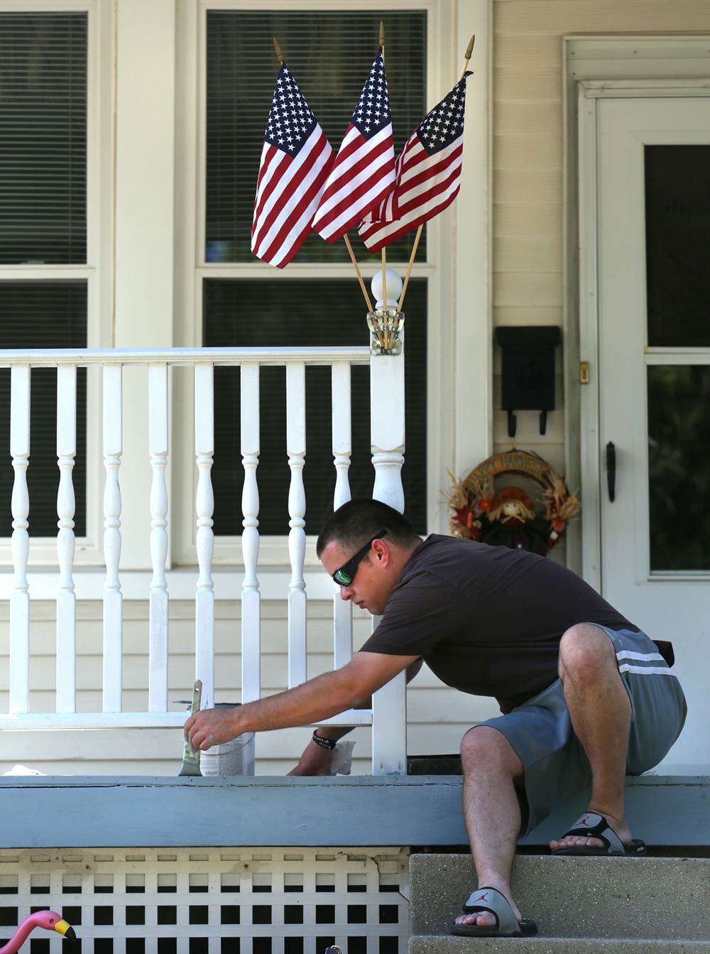 A perfect Fall day gave Springfield resident Travis Teimeyer the perfect excuse to be outside while painting the front porch of his N. Sixth St. home on Monday afternoon, Sept. 29, 2014. Teimeyer said he was using non-skid paint for the job so slippery conditions he had encountered in Winters past on the porch surface would be eliminated. David Spencer/The State Journal-Register