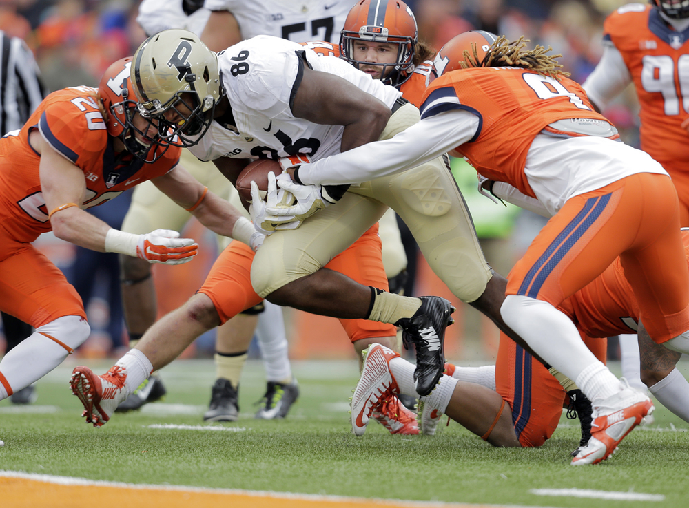 Illinois' Clayton Fejeledem (20) and Earnest Thomas (9) stop Purdue's Gabe Holmes short of the end-zone at Memorial Stadium in Champaign Saturday, Oct. 4, 2014. Ted Schurter/The State Journal-Register