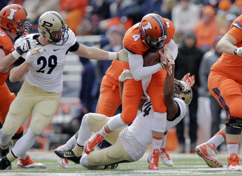 Purdue's Frankie Williams brings down Illinois quarterback Reily O'Toole at Memorial Stadium in Champaign Saturday, Oct. 4, 2014. Ted Schurter/The State Journal-Register