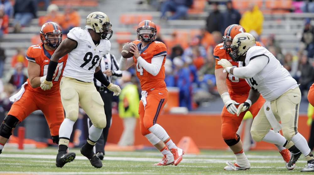 Illinois' Reily O'Toole look to pass against Purdue at Memorial Stadium in Champaign Saturday, Oct. 4, 2014. Ted Schurter/The State Journal-Register