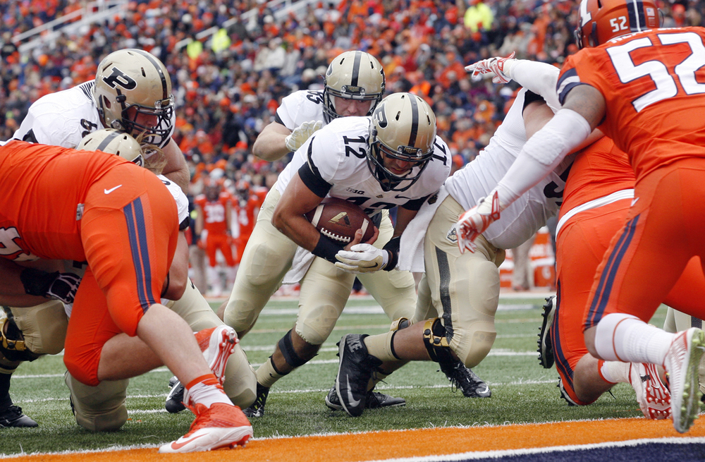 Purdue's Austin Appelby plows into the end-zone for a touchdown at Memorial Stadium in Champaign Saturday, Oct. 4, 2014. Ted Schurter/The State Journal-Register