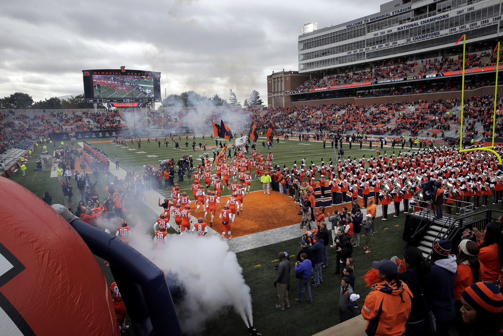The Fighting Illini take the field against Purdue at Memorial Stadium in Champaign Saturday, Oct. 4, 2014. Ted Schurter/The State Journal-Register
