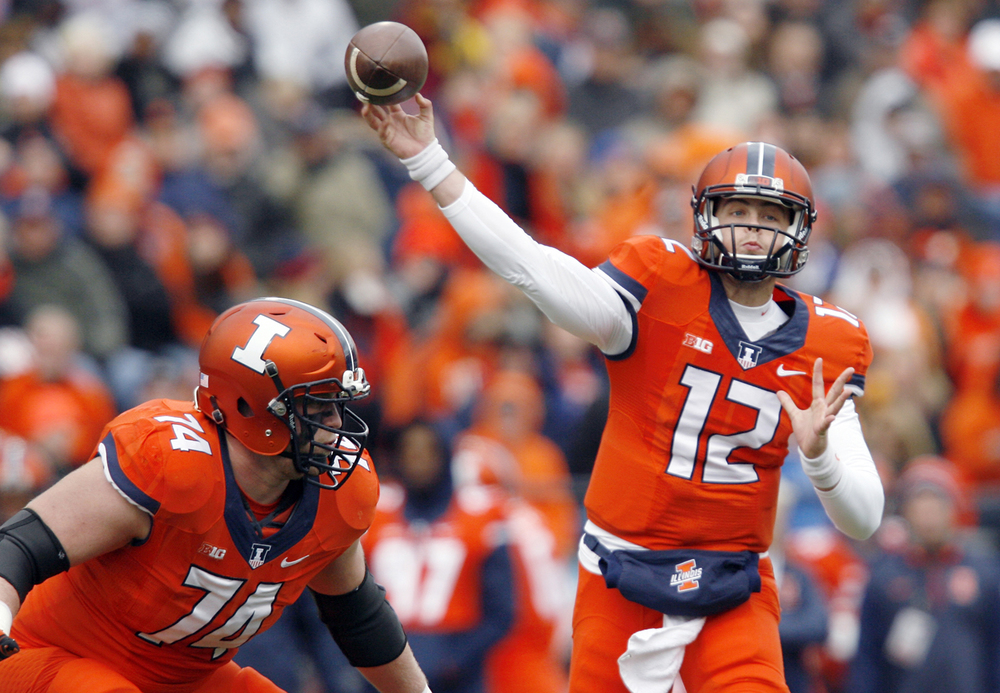 Illinois quaterback Wes Lunt fires a pass against Purdue at Memorial Stadium in Champaign Saturday, Oct. 4, 2014. Ted Schurter/The State Journal-Register