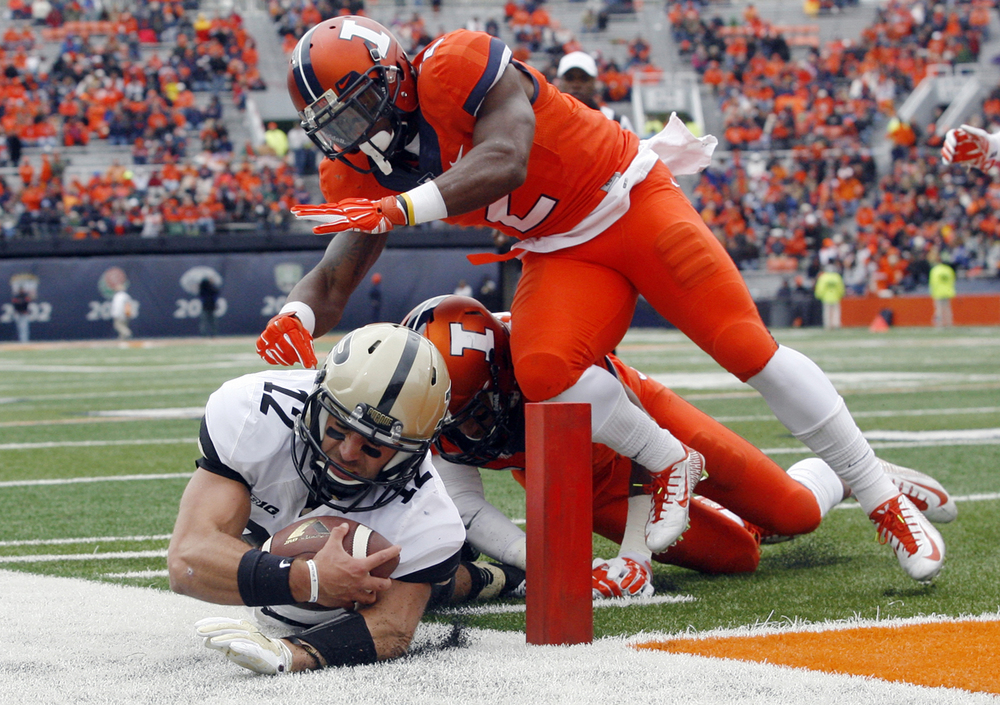 Purdue quarterback Austin Appleby dives the end-zone but comes up short at Memorial Stadium in Champaign Saturday, Oct. 4, 2014. Ted Schurter/The State Journal-Register