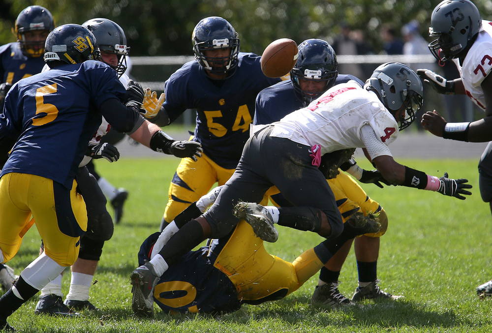 The ball is fumbled by Senators ball carrier Rankeem Hawkins but was recovered by Springfield. The Springfield Southeast High School Spartans defeated the Springfield High School Senators 38-7 in football actions at the Spartans home field on Saturday, Oct. 4, 2014. David Spencer/The State Journal-Register