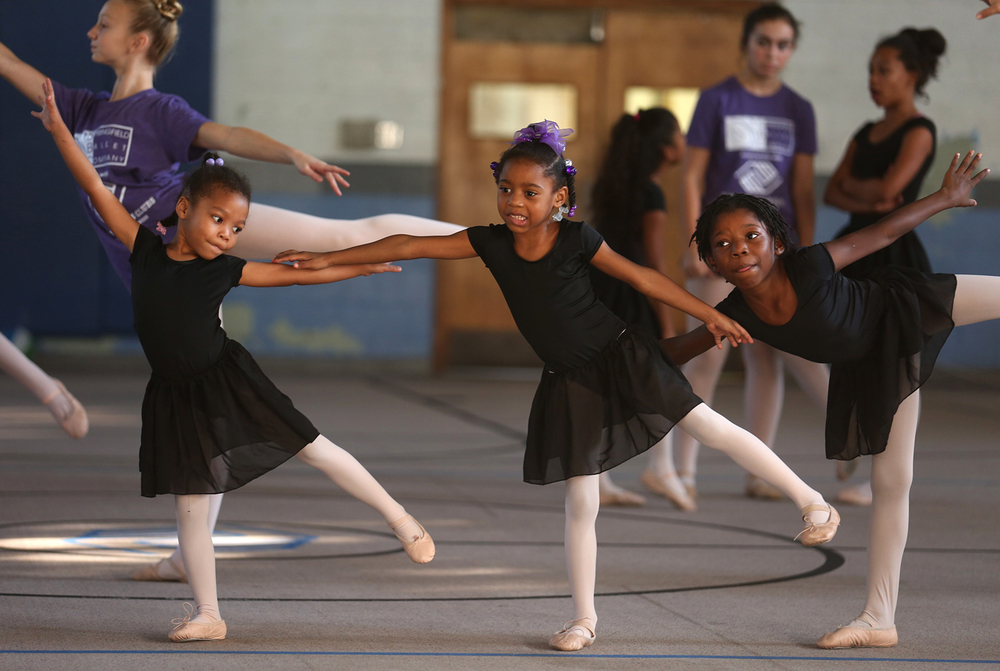 Ballerinas from left to right learn technique during their first ever ballet class. From left to right: Keairah Kingcade, 5, Rosalind Thomas, 5, Charligail Thomas, 8. Instructors and Company members from The Springfield Ballet Company teach a beginning ballet class emphasizing technique to aspiring ballerinas at the Boys and Girls Club of Springfield on Friday, Sept. 19, 2014. David Spencer/The State Journal-Register
