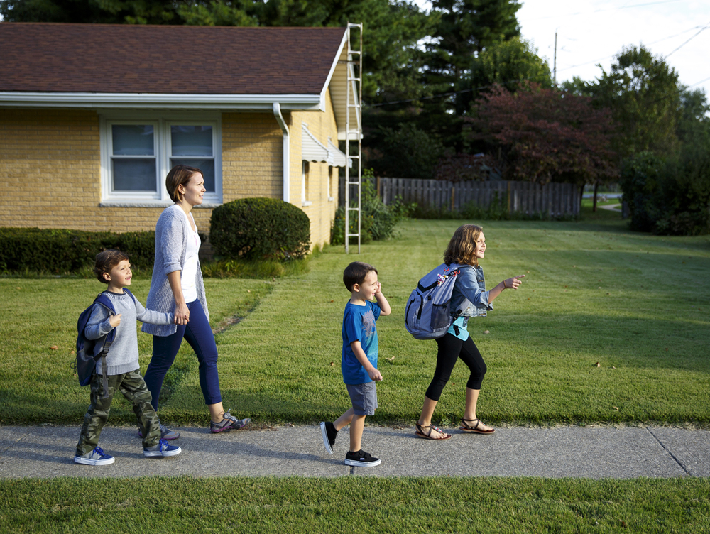 Amy Marx walks with her children two blocks to Owen Marsh school Thursday, Sept. 25, 2014, where Ian, left, and Ava are students. Her youngest son, Leo, is in preschool. Rich Saal/The State Journal-Register