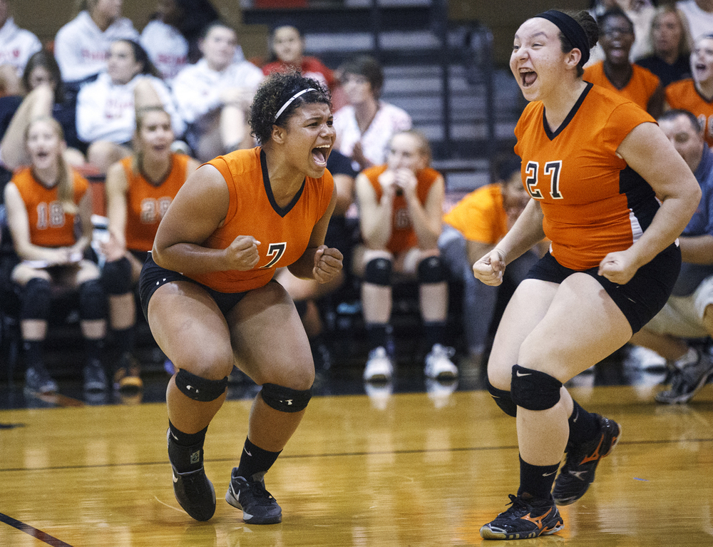 Lanphier's Keona Bolden, left, and Vanessa Reed celebrate as they rally against Sacred Heart-Griffin during the 2014 Girls City Tournament at Springfield High School Wednesday, Sept. 24, 2014.  Ted Schurter/The State Journal-Register