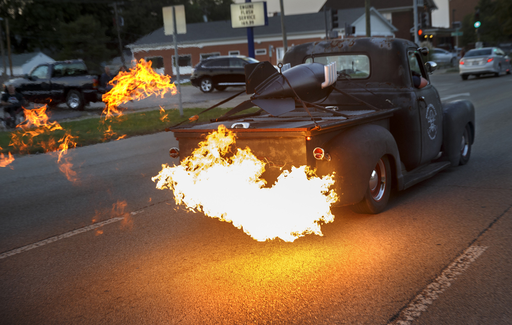 A custom pickup belches flame as it parades down Sixth Street during the Route 66 Mother Road Festival cruise Friday, Sept. 26, 2014. Ted Schurter/The State Journal-Register