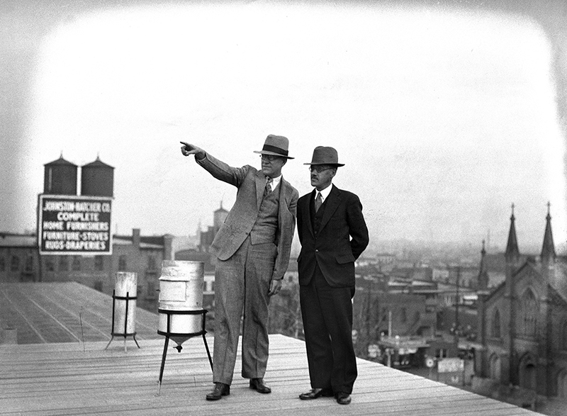 """Over yonder is where winter is hiding,"" W.F. Feldwish, left, told Elward Holcomb, the new manager of the local weather bureau, during a trip to the roof of the federal building where weather monitoring equipment was kept. Holcomb moved from Mobile, Ala., and told Feldwish he was looking forward to a Midwest winter so he could experience snow, November 6, 1932."