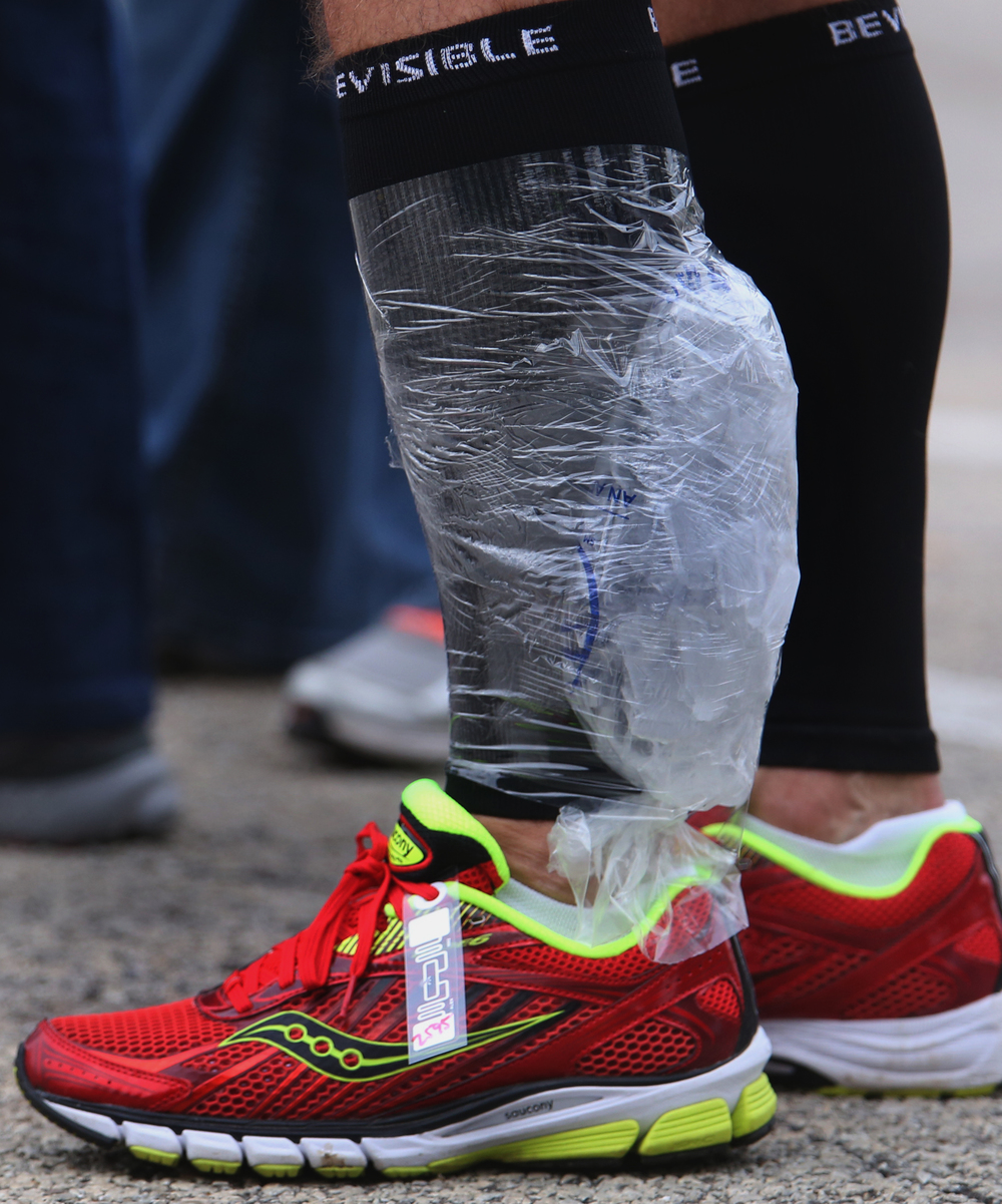 Rick Hernandez of Springfield, one of the top finishers in the 10K race Sunday, was walking around the finish line after his race with an ice pack wrapped around his leg in order to soothe cramping. The second annual Springfield Marathon, including a combined half-marathon and 10K road races and sponsored by Springfield Clinic, started and finished at the University of Illinois at Springfield on Sunday, Oct. 19, 2014. Registration totals included 117 for the marathon, 423 for the half-marathon and 187 for the 10K. David Spencer/The State Journal-Register