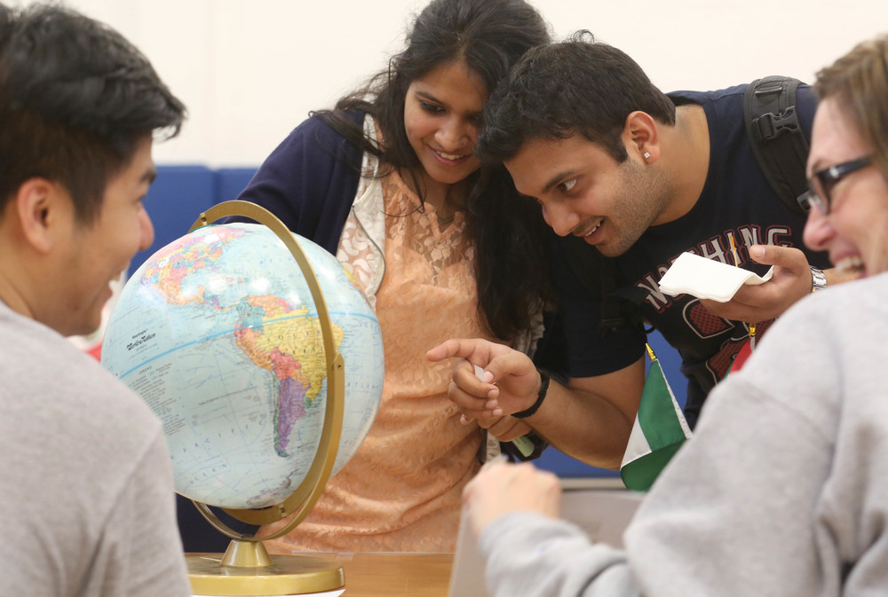 "Looking for the Gobi Dessert on a globe took a bit of sleuthing for UIS students Prakruti Agarwal at left and Krishna Kant, who were taking part in a geography game sponsored by the UIS International Services Department as part of the festival Friday night. Finding places correctly within a certain amount of time earned restaurant gift certificates for those trying their hand at it. ""One World, One Beat!� was the theme for this year's International Festival held in the Recreation and Athletic Center at the University of Illinois at Springfield on Friday evening, Oct. 24, 2014. Featuring cultural exhibits, artistic performances, and food tasting, the cultural diversity of the student body was on display including those from African nations, China, India, Ireland, Peru, Turkey, Scotland, and others. David Spencer/The State Journal-Register"