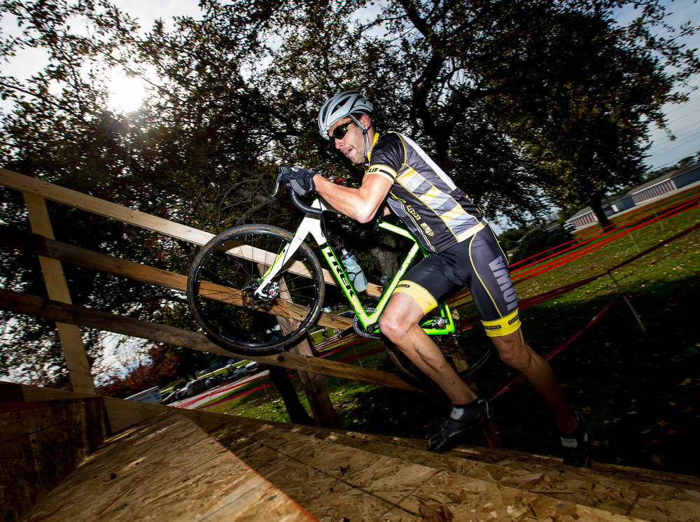 "Sam Strawhacker, of Iowa City, Iowa, lifts his bike as he hits the stairs on the flyover obstacle during the Pumpkin Hop cyclocross race at Roberts Park, Saturday, Oct. 11, 2014, in Beardstown, Ill. Strawhacker is a road racer for the University of Iowa and just got into cyclocross. ""Just trying to improve my road riding, but this is a little bit more fun,"" said Strawhacker. Justin L. Fowler/The State Journal-Register"