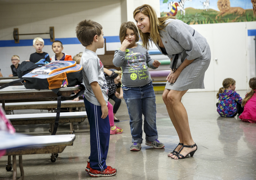 North Elementary School principal Brandi Bruley visits with students before the school day begins Thursday, Oct. 23, 2014. Bruley recently won an award from the National Association of Elementary School Principals.  Ted Schurter/The State Journal-Register