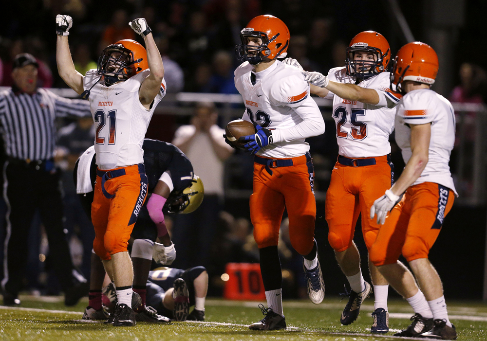 Rochester's Kenny Hedges (21) celebrates after the Rockets recovered a fumbled punt against Sacred Heart-Griffin in the second quarter Friday, Oct. 24, 2014. Ted Schurter/The State Journal-Register