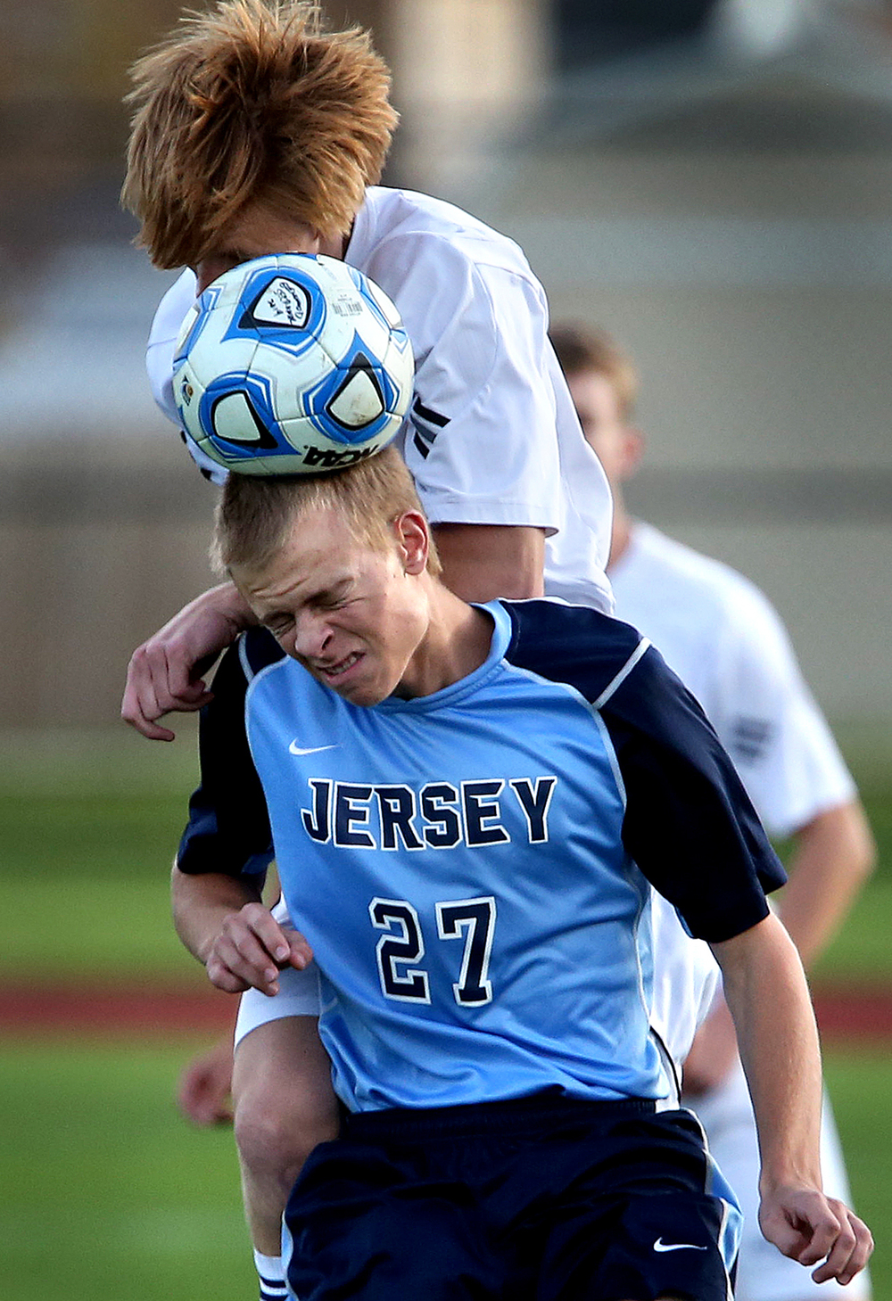 Rockets player Michael Harry and Jersey player Drake Blackwell head the ball at the same time during first half action. The Rochester High School Rockets defeated the Jerseyville High School Panthers 4-1 at the boys Class 2A Chatham Glenwood Sectional soccer tournament at Glenwood High School on Tuesday, Oct. 28, 2014. David Spencer/The State Journal-Register