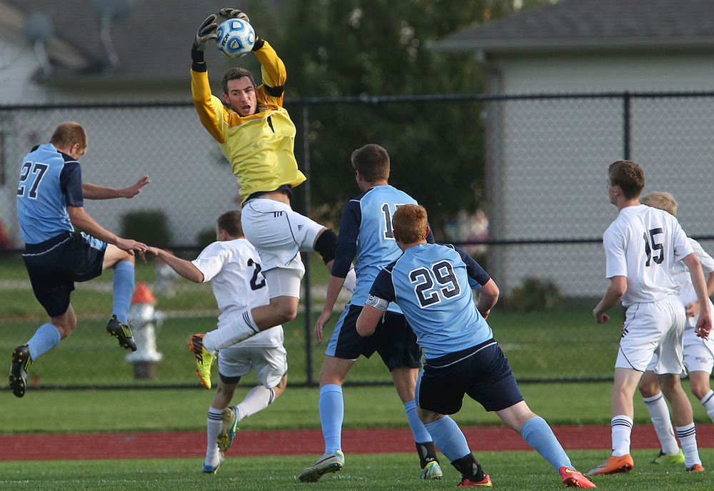 Rockets goal keeper Tyler Schlecht makes a save against Jerseyville. The Rochester High School Rockets defeated the Jerseyville High School Panthers 4-1 at the boys Class 2A Chatham Glenwood Sectional soccer tournament at Glenwood High School on Tuesday, Oct. 28, 2014. David Spencer/The State Journal-Register