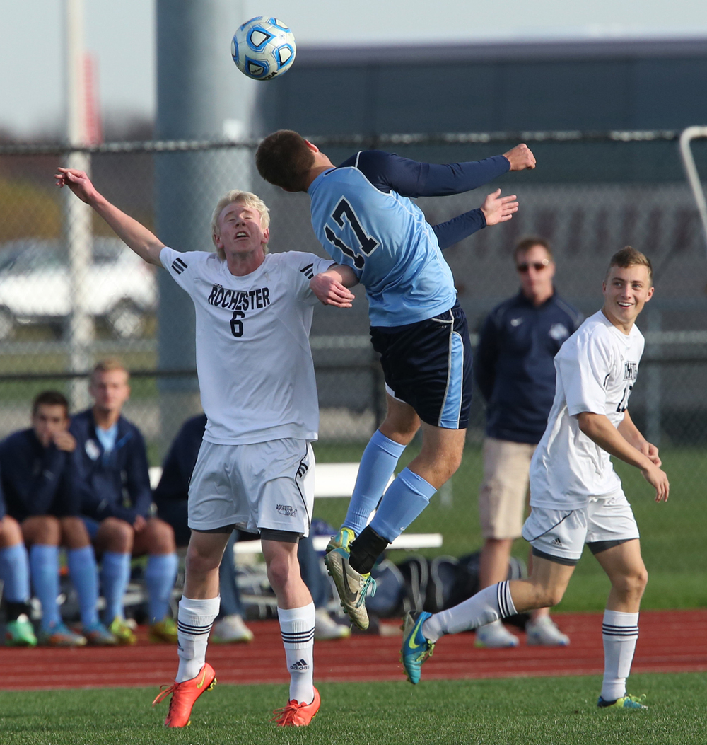 Going up for a header are Rockets player Josh Segatto at left and Jerseyville player Jordan Jones. The Rochester High School Rockets defeated the Jerseyville High School Panthers 4-1 at the boys Class 2A Chatham Glenwood Sectional soccer tournament at Glenwood High School on Tuesday, Oct. 28, 2014. David Spencer/The State Journal-Register