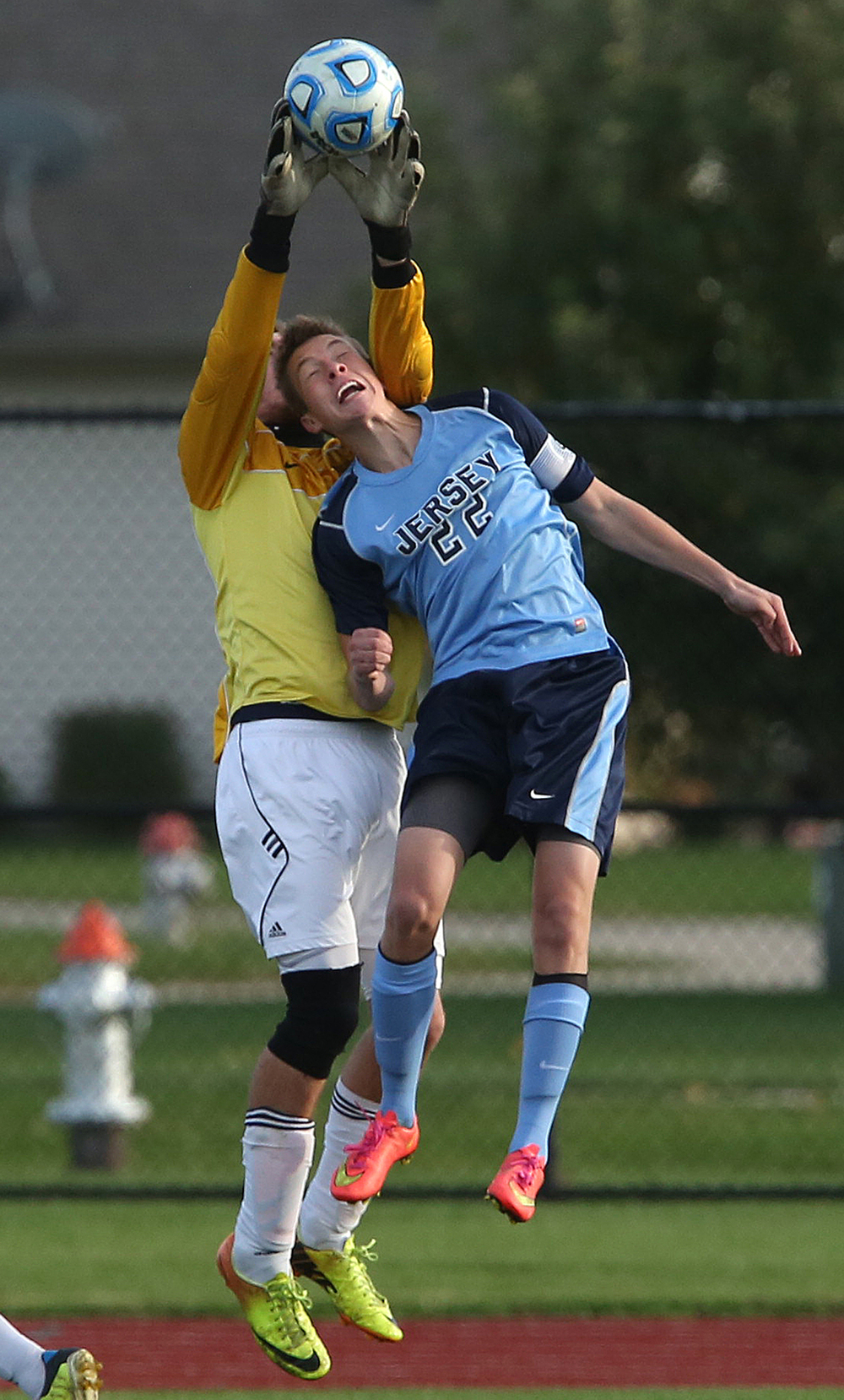 Rockets goal keeper Tyler Schlech makes a save in front of Jerseyville player Chace Tallman. The Rochester High School Rockets defeated the Jerseyville High School Panthers 4-1 at the boys Class 2A Chatham Glenwood Sectional soccer tournament at Glenwood High School on Tuesday, Oct. 28, 2014. David Spencer/The State Journal-Register