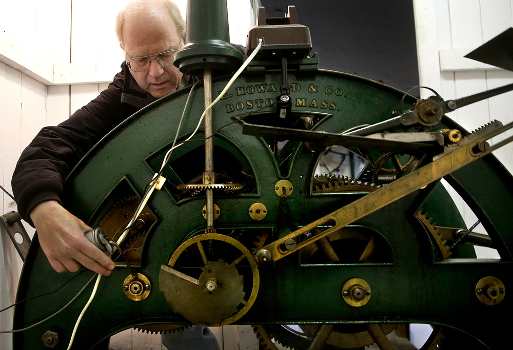 Bill Kennedy oils the tower clock at the Christian County Courthouse Oct. 25, 2014. Kennedy has been winding the clock every Saturday for 25 years. The clock, a Howard Round Top model, was built in 1902.