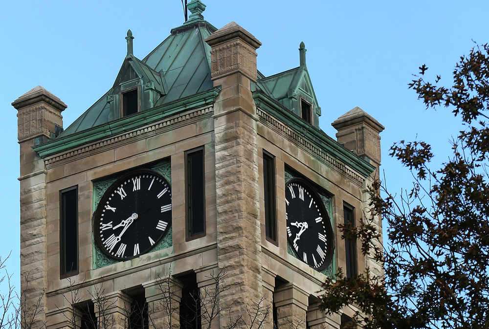 There are four clock faces atop the courthouse clock tower, two of which can be seen here. Each individual face is eight ft. in diameter and are 80' off the ground from the middle of the clock face. The Christian County Courthouse clock in Taylorville, in operation since 1902 when the building was dedicated, has been restored by Taylorville businessman Bill Kennedy, who is the keeper of the clock tower. Once a week on Saturday morning, Kennedy makes the journey to the top of the three-story courthouse and winds the clock. These photographs were taken on Saturday, Oct. 25, 2014.  David Spencer/The State Journal-Register