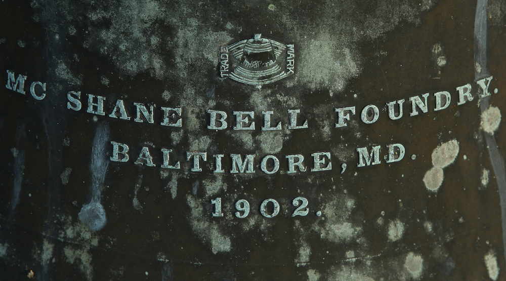 The bell was cast by the McShane Bell Foundry of Baltimore, MD in 1902. It's struck hourly by a separate 16 lb hammer.